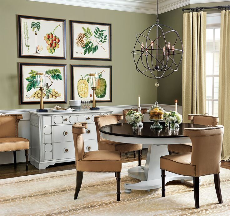 Earth tones like an olive green wall color and velvet chairs in rich ochre make this dining room designed by Bunny Williams a warm, inviting space to entertain.