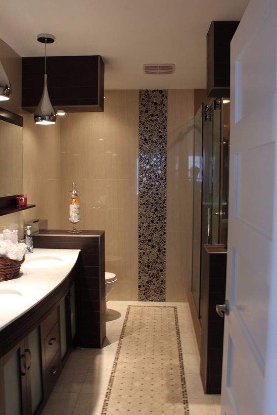 Turn your bathroom into the perfect oasis with accent wall tiling and a unique glass shower. Build your perfect dream bathroom with SCD Design & Construction!