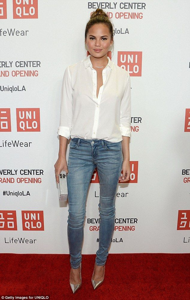 Classic: Christine Teigen opted for one of the most simple yet effective looks ever - the white shirt and skinny jeans combo - at the launch of LA's first UNIQLO store