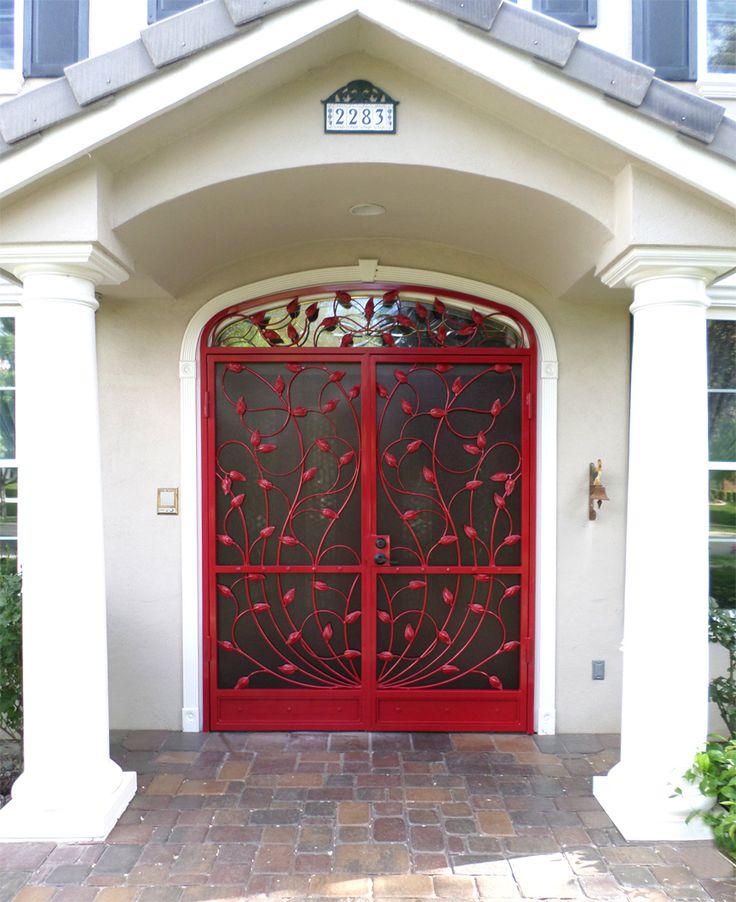 Double wrought iron vine security door wrought iron for Wrought iron security doors