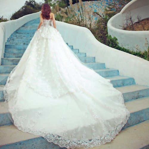 Extremely long laced wedding dress.