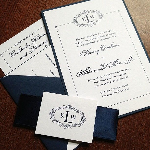 navy blue and white wedding invitation with satin ribbon
