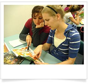 SYLLABUS BITES creating digital and multimodal texts  Two girls analysing a children's picture book as part of a visual literacy activity.
