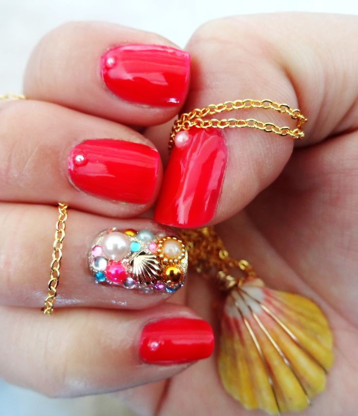 """Beach Theme Nail Art. Maybelline Color Show """"Pink Shock"""" with pearl details. Ring finger painted with Orly """"Luxe"""" and Maybelline Color Show """"Gilded Rose,"""" and covered with various pearls, crystals, and a metal shell. #nailart"""