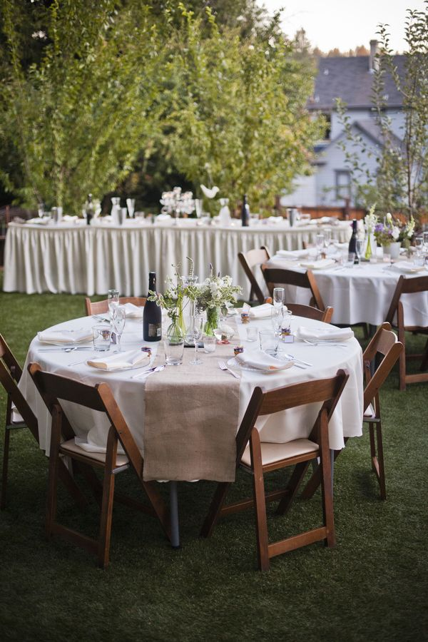 wedding inspiration, reception tables, wooden chairs, burlap runners, glass vases, white flowers, purple flowers