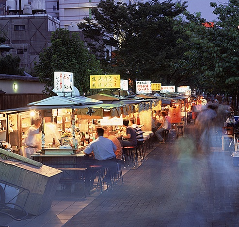 Hakata, Fukuoka: Yatai (屋台 / やた)い)lined up offering food and drink for their evening customers. Hakata is famous for their Yatais.