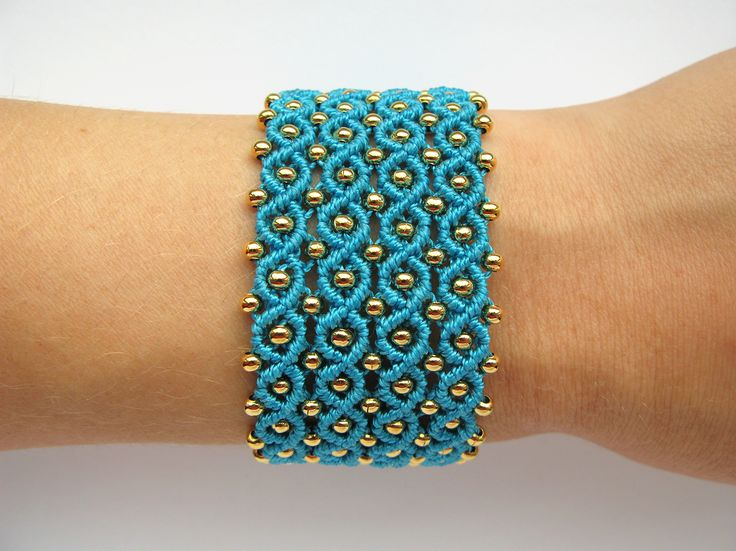 Wide turquoise micro-macrame bracelet with gold metal beads.