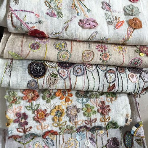These are totally beautiful, one-of-a-kind linen handmade wraps, shawls and scarves.<br />They are either hand embroidered or crocheted, or both, on or with 100% linen.<br />Often the threads are hand-dyed using vegetable dyes.