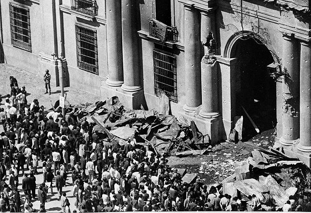 La Moneda after hawker hunters air force attack (Sep.1973).People visiting building.