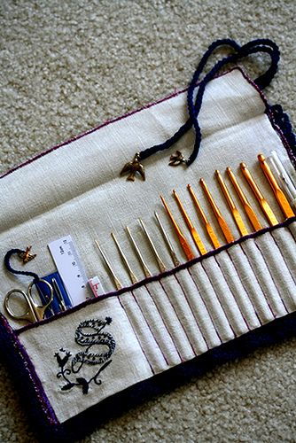 inside handmade crochet needle case with gold bird