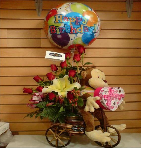 Regala arreglo floral en base de bicicleta con globo y - Hacer munecos con globos ...
