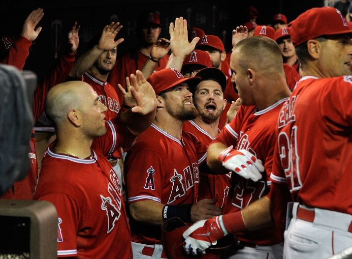 The Angels congratulate Mike Trout on a grand slam in MIN // Sept 2015