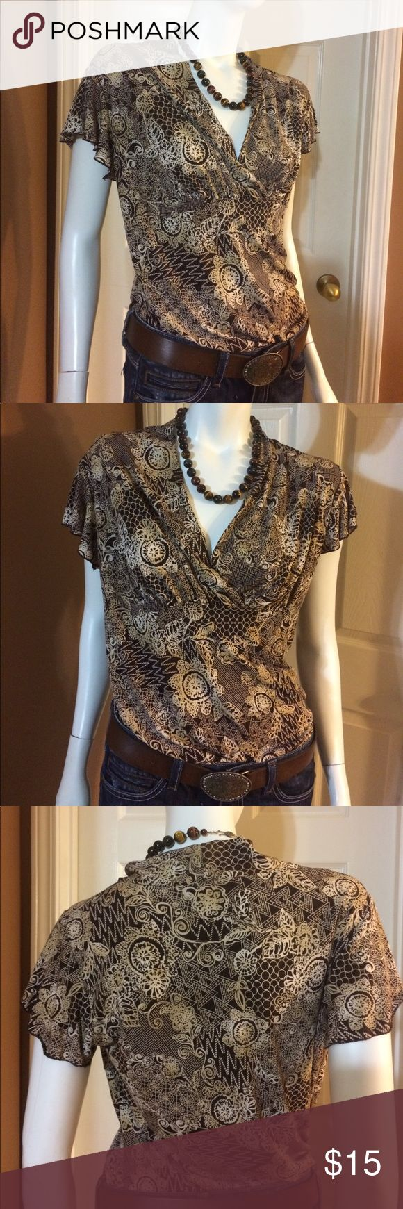 🔅BOGO🔅Brown And Cream Short Sleeve JKLA Top Gently worn. Size large Brown And Cream Short Sleeve JKLA Top. 92% polyester, 8% spandex.  Top is approximately 26 inches long and 19 inches from armpit to armpit.  No rips, stains or tears. Non-smoking home. JKLA Tops