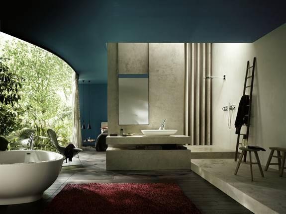 Ontwerper Philippe Starck maakte jaren geleden al badkamerontwerpen met een originele invalshoek: Hij wilde kunnen leven in de badkamer. De setting van zijn nieuwe kranencollectie Organic voor Axor is duidelijk: uitzicht op een tropische tuin, tapijt voor meer sfeer, makkelijke stoelen om in te relaxen en te lezen. Een originele badkamer voor meer dan douchen alleen.