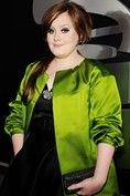 Feb.8,2009 wearing a chartreuse satin coat by Barbara Tfank at the 51st Annual Grammy Awards, Los Angeles, where she won Best New Artist