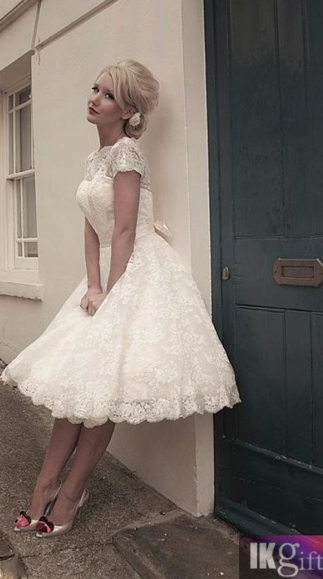 Short wedding dress with short sleeves and a full skirt. If not for the wedding then this dress is right up my alley for a rehearsal dinner or bridal shower (price depending lol)