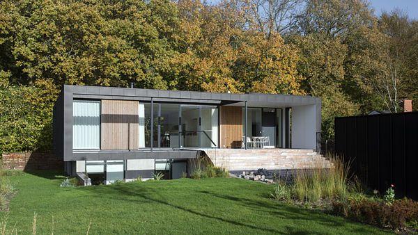 Okraj lesa je přirozenou kulisou domu.