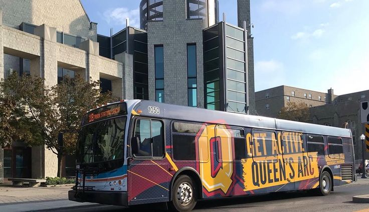 Not your average city bus... Keep an eye out for the Gaels transit bus  Peep the back for the Queen's football home schedule