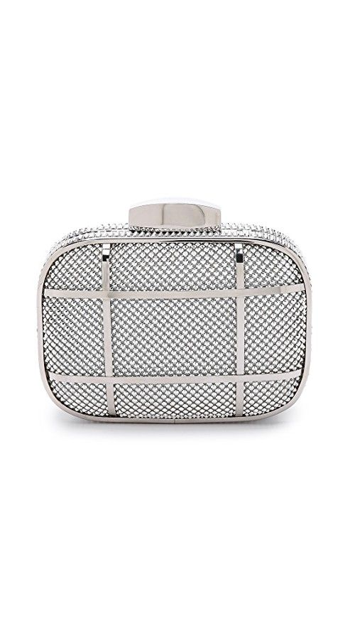 Whiting & Davis Cage Minaudiere Clutch | Studded metal mesh lends a hit of rock-n-roll attitude to a petite minaudiere. Glossy bands add a graphic edge, and the top opens with a sleek push lock. The chain strap tucks inside the logo-lined interior when not in use. Weight: 12oz / 0.34kg. Imported, China. Measurements |  Height: 4in / 10cm Length: 6in / 15cm Depth: 1.5in / 4cm Strap drop: 21in / 53.5cm