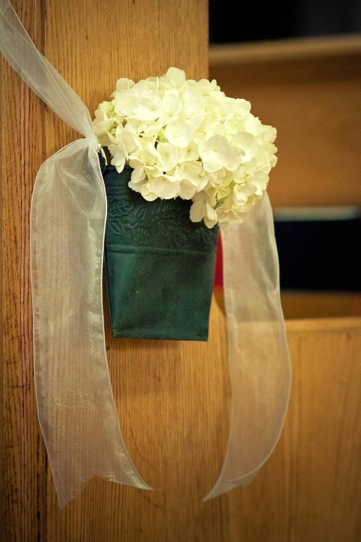 DIY wedding flowers to hang on pews in church...Dollar Store tin buckets filled with freshly cut hydrangeas and finished with sheer white ribbon.
