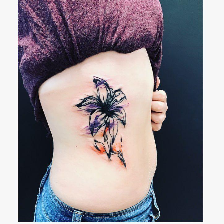 First little watercolor piece! Beautiful piece and wonderful client ☺️ #blessed #watercolor #ink #inked #tattoo #tattooartist #tattooideas #tatz #titz #love #ribs #lily #flower #scribble #awesome #art #artist #nebraska #colorado #travel #instagood #follow http://misstagram.com/ipost/1544595612825865030/?code=BVvgYa4HMtG