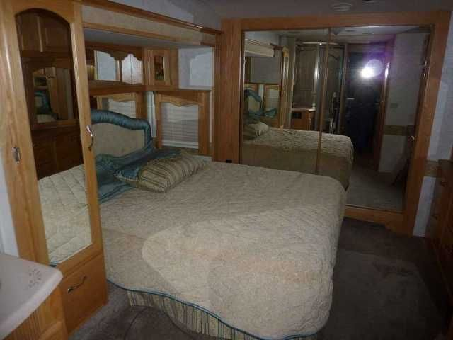 2004 Used Teton Grand Frontier Fifth Wheel in Colorado CO.Recreational Vehicle, rv, 2004 Teton Grand Frontier , Some of the features are; Big Foot leveling, hydraulic disc brakes, Michelin tires, SXS with icemaker, Precision Temp tankless waterheater, oak cabinetry and window treatments throughout, upgrade carpet and sleeper sofa, Sleep Number queen bed, 32 in LCD TV in Living room, 21 in LCD TV in Bedroom. Haier washer, Arctic package with double pane thermal glass. Coach was full painted…