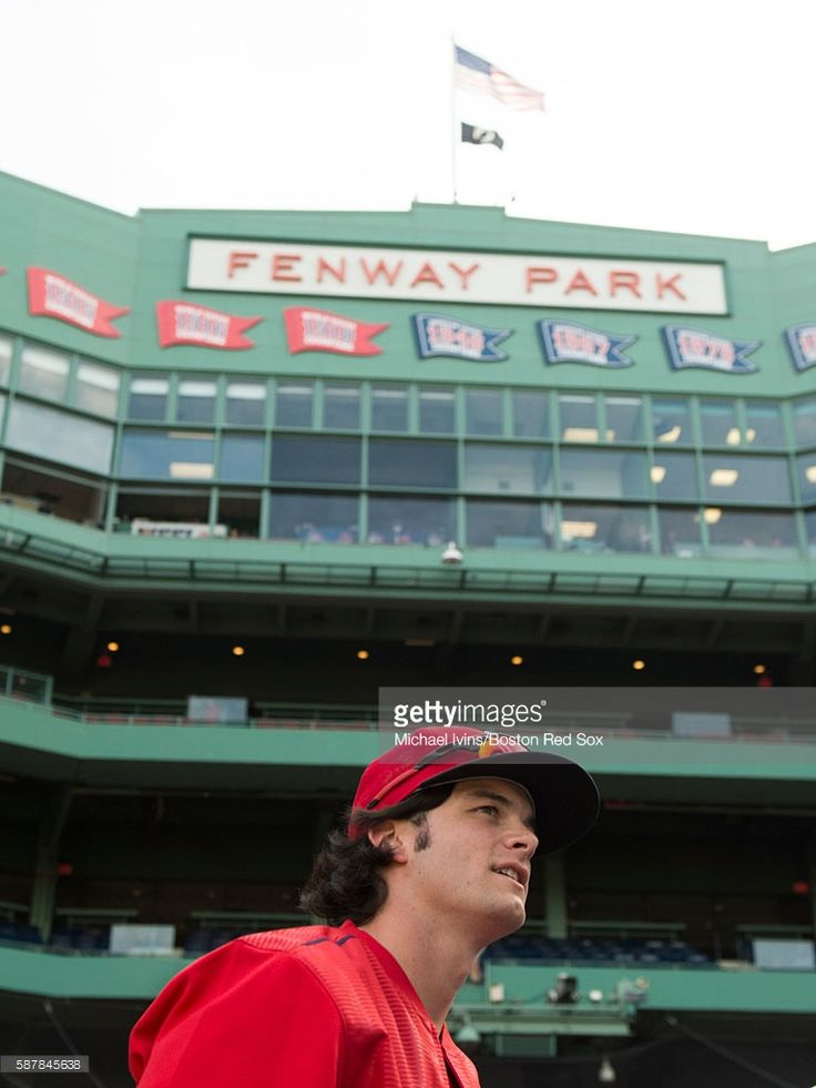 Andrew Benintendi #40 of the Boston Red Sox waits to take batting practice before a game against the New York Yankees on August 9, 2016 at Fenway Park in Boston, Massachusetts.