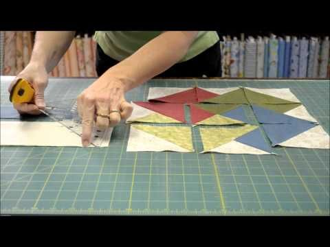 "::Demo: Quarter-Square Triangle Ruler::    In this demonstration, Kathy shows how to use a quarter-square triangle ruler while providing tons of helpful tips and teaching another ""quilt math"" lesson! She also highlights two quilt patterns, QP Quilts & Co.'s Ohio Star and Winning Hands, for mastering quarter- and half-square triangles.    Need to brush up on the traditional and ruler-method of making half-square triangles? See the demo on our YouTube channel @ http://goo.gl/MMBpb."