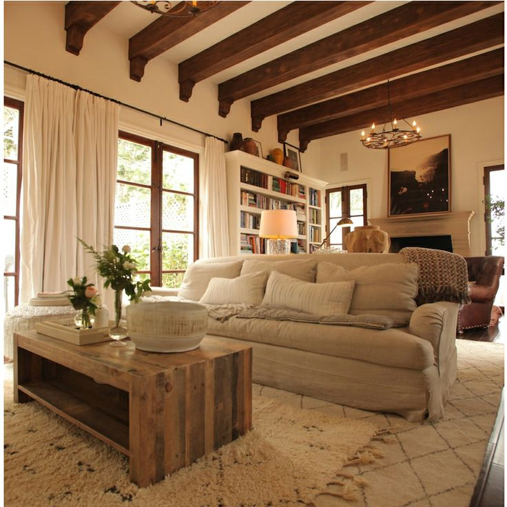 {Cozy, rustic living room - wood beans, neutral colors, wood coffee table}