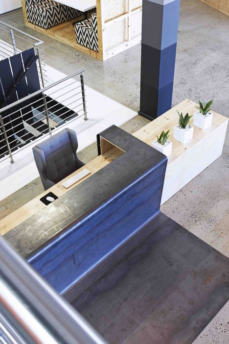 Reception desk 99c offices by Inhouse Brand Architects feature a waiting room inside a shipping container