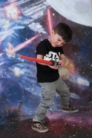Star Wars inspired kids photography photo shoots at ZigZag Photography studio in Leicester #starwars #lightsaber #vinyl #backdrop #background #space #photoshoot