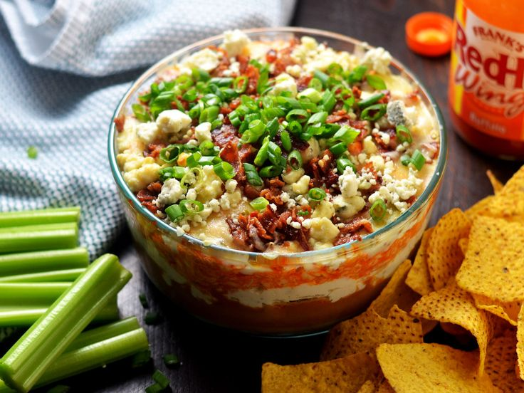 Buffalo chicken dip gets the seven-layer treatment with refried beans, pepper jack cheese, blue cheese crumbles, crispy bacon, and more.