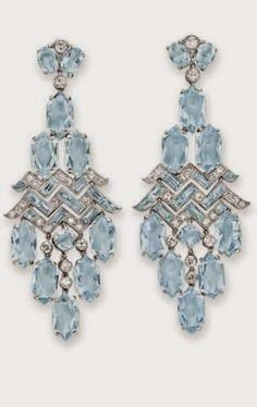 A PAIR OF ART DECO AQUAMARINE AND DIAMOND EAR PENDANTS, BY CARTIER Each of chandelier design, suspending a fringe of hexagonal-cut aquamarines, ...