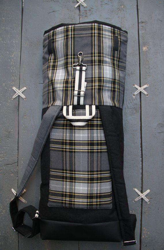 """Upcycled black and grey roll top rucksack with back pocket for tablet where the back pocket from a men's trousers has been used on the front creating a double pocket, by """"EatingTheGoober"""""""