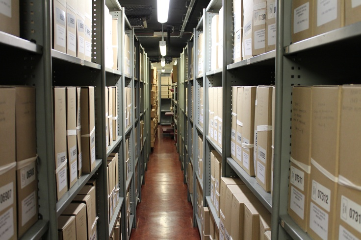 An image from our basement stores. Guildhall Library is a public reference library - anyone is able to visit and request items to be sent up from our stores. You should not need to wait longer than 20 minutes for any item. Rare items require a valid ID to be presented.