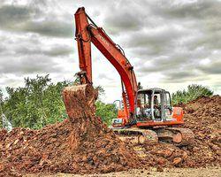 Excavators make light work of pond construction.
