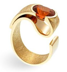 "Ring | Thierry Vendome.  ""Yellow Ribbon"".  Garnet and yellow gold"