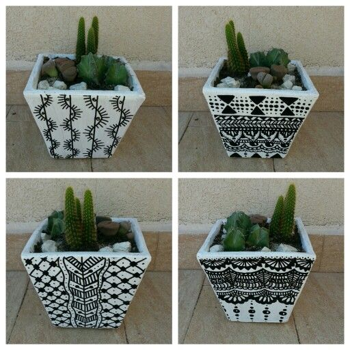 black and white painted terracotta pots