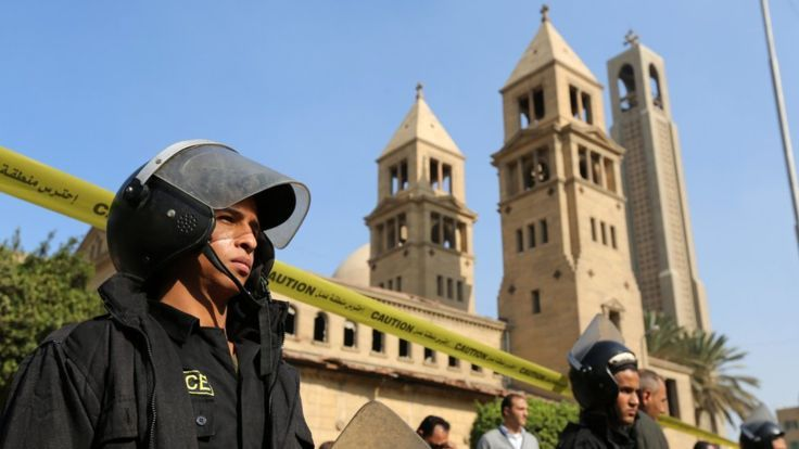 Members of the special police forces stand guard to secure the area around St. Mark's Coptic Orthodox Cathedral after an explosion inside the cathedral in Cairo