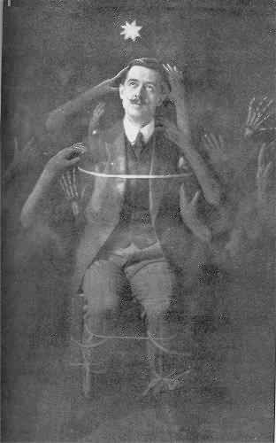 "Victorian spirit photography  Man with many spirits. ""hands touching 'pinching' in the dark"""
