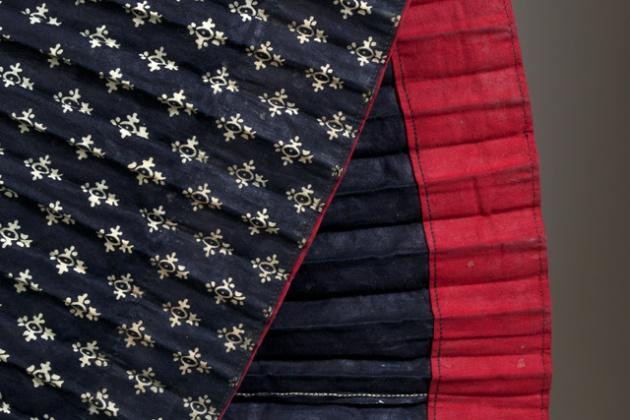 Detail of Slovak skirt showing red hem. Modrotlac.