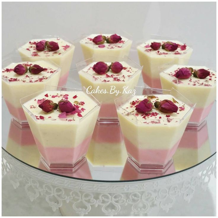 Vanilla bean Panna Cotta topped with edible roses Cakes.By.Kaz