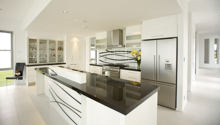 Black granite benchtops provide the working surface in this island kitchen.