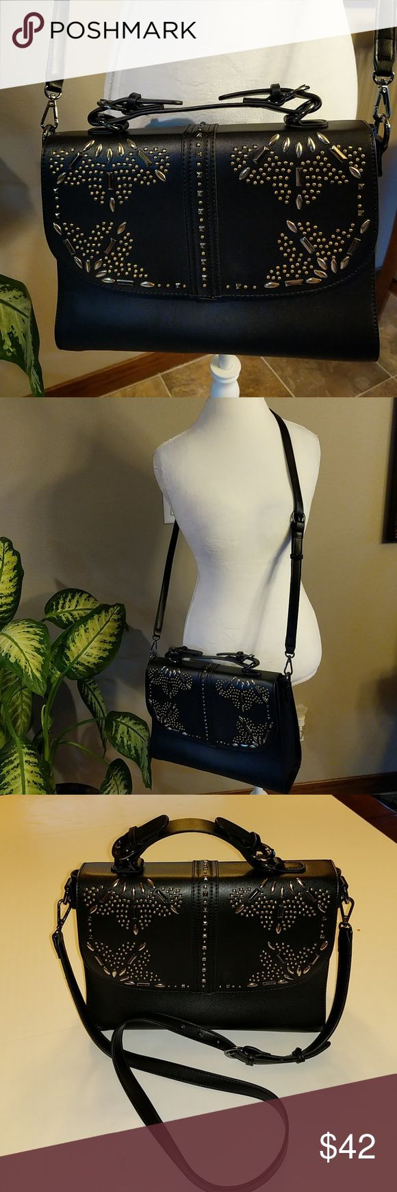 Chelsea28 black crossbody purse New without tags Chelsea 28 crossbody or handled purse. Silver and a darker black Hardware snap closure one zip compartments inside, and one not zip. Back has one zip compartment. All man-made material chelsea 28 Bags Crossbody Bags