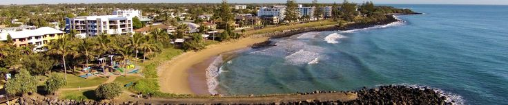Aerial shot of Bargara where the turtle park is, showing the ocean, rock pier, turtle park and streets.