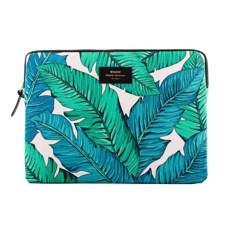 Tropical 13 är ett laptopfodral med tryck från Wouf. Fodralet har ett mönster med gröna/blå blad på ...