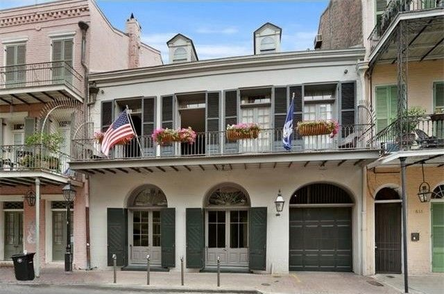 Brad and Angelina have listed their French Quarter Mansion in New Orleans for 6.5 million.  It has 5 bedrooms, 5 baths and all the grandness you'd expect with Venetian plastered walls, marble mantles and fireplaces, crown moldings, a grand spiral staircase and — bringing it into the modern era — an elevator. There's also a 2-story guesthouse.