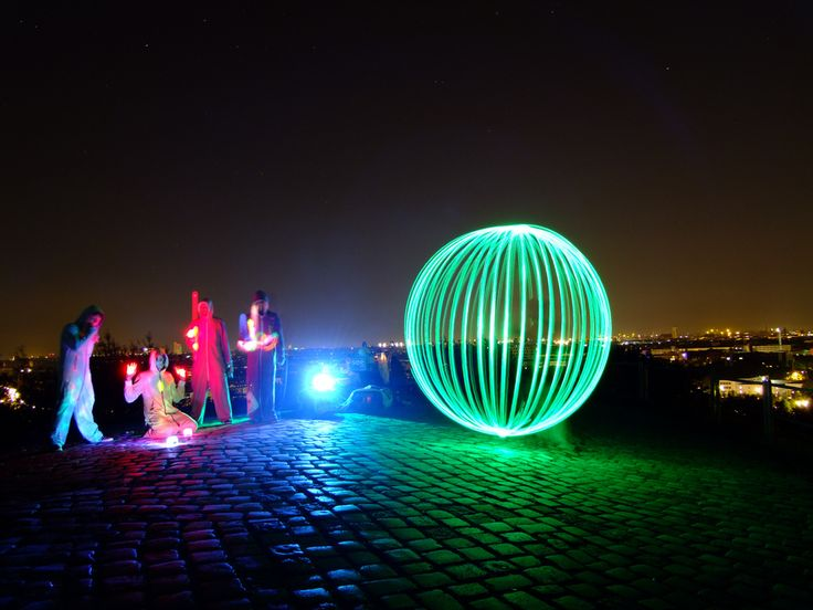 https://flic.kr/p/adnHQU | Juggling with a light orb | This light orb orb met some jugglers having fun on the Olympiaberg during the EJC 2011 in Munich.  Think I absolutely need such OnePiece garment myself! Black would be great. ;-) Thanks for that funny session, jugglers!