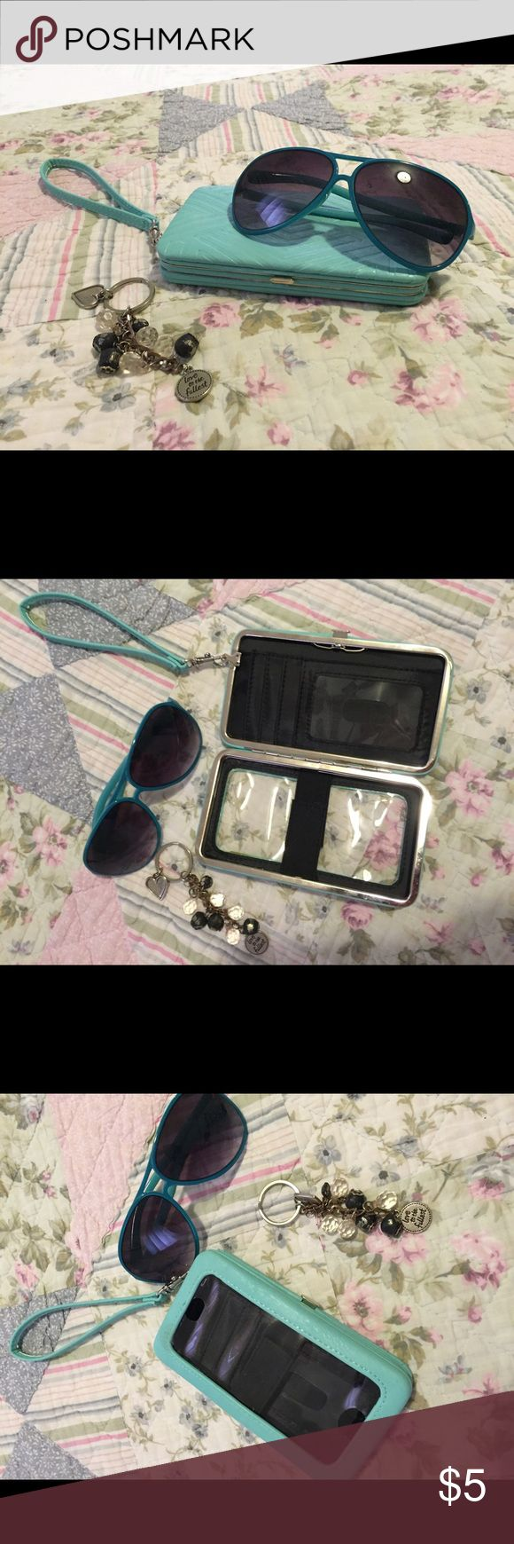 """iPhone 6 clutch with sunglasses and keychain Bundle it! iPhone 6 clutch. Holds phone and has a place for ID, cash, and cards. Also, blue sunglasses, and a keychain. Unsure of name brands on any of the items. The plastic looks """"warped"""" slightly, but it still allows you to function your phone fine. Other"""