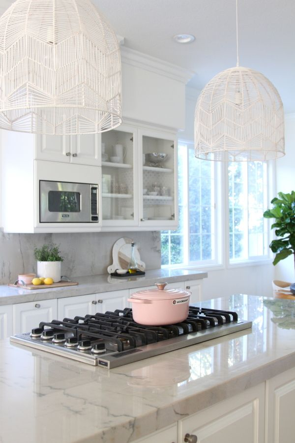 An all white modern kitchen: http://www.stylemepretty.com/living/2016/11/18/tour-a-bright-white-kitchen/ Photography: Becki Owens - http://beckiowens.com/